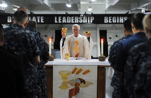 U.S. Navy Lt. William Dorwart, a chaplain on the aircraft carrier USS Ronald Reagan, celebrates Mass in San Diego in this 2010 photo.U.S. Navy photo by Mass Communication Specialist Seaman Benjamin C. Jernigan